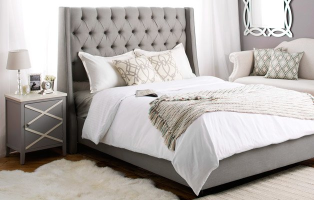 Grey glam bedroom with tufted headboard